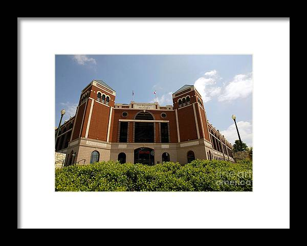 American League Baseball Framed Print featuring the photograph Ameriquest And Texas Rangers Strike by Ronald Martinez