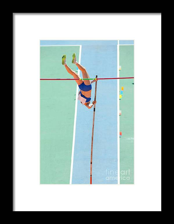 Woman Framed Print featuring the photograph An Athlete Attempts Successful A Pole by Maxisport