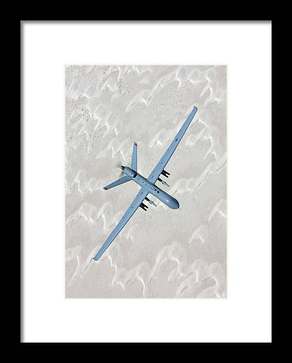 Aerodynamic Framed Print featuring the photograph An Mq-9 Reaper Flies A Training Mission by High-g Productions/stocktrek Images
