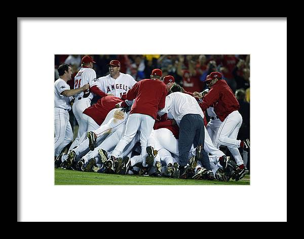 Los Angeles Angels Of Anaheim Framed Print featuring the photograph Angels Celebrate by Al Bello