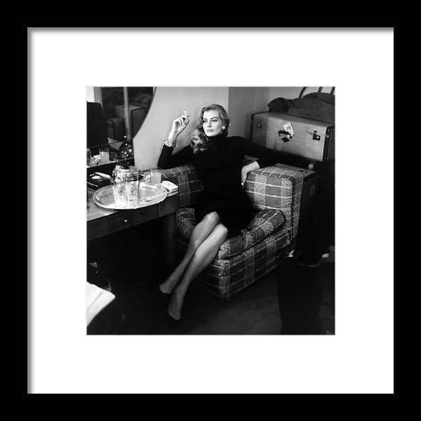 Smoking Framed Print featuring the photograph Anita Ekberg by Bob Haswell