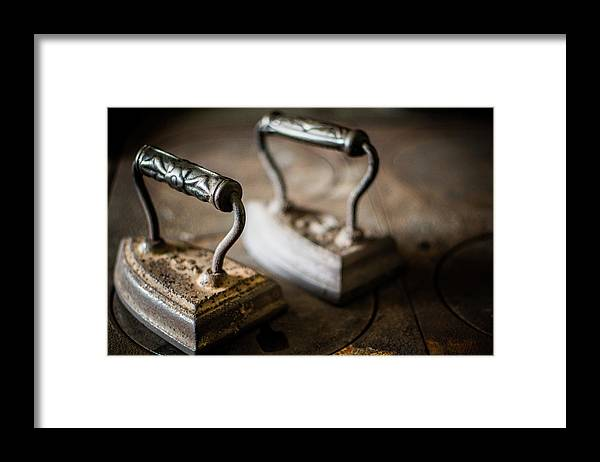 Two Objects Framed Print featuring the photograph Antique Irons by Jimss