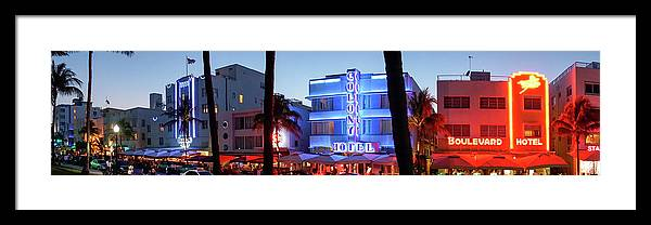 Panoramic Framed Print featuring the photograph Art Deco Hotels On Ocean Drive At Dusk by Buena Vista Images