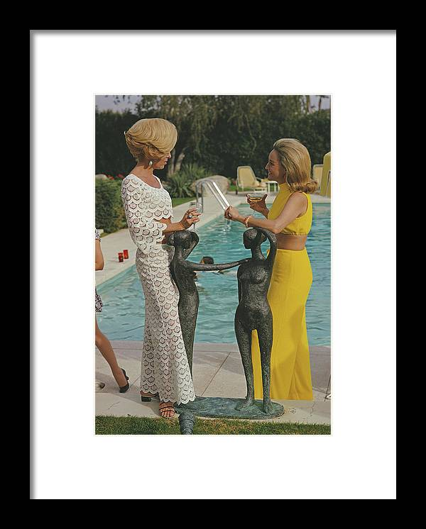 Fashion Model Framed Print featuring the photograph At The Kaufmann Desert House by Slim Aarons