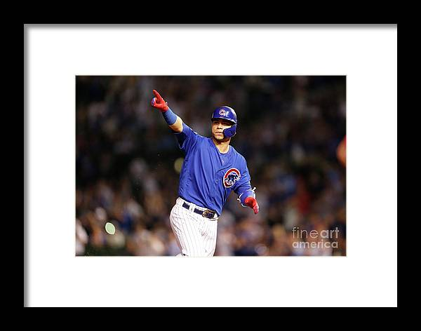 Following Framed Print featuring the photograph Atlanta Braves V Chicago Cubs by Nuccio Dinuzzo