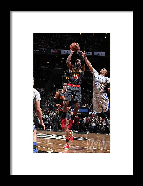 Tim Hardaway Jr. Framed Print featuring the photograph Atlanta Hawks V Brooklyn Nets by Nathaniel S. Butler