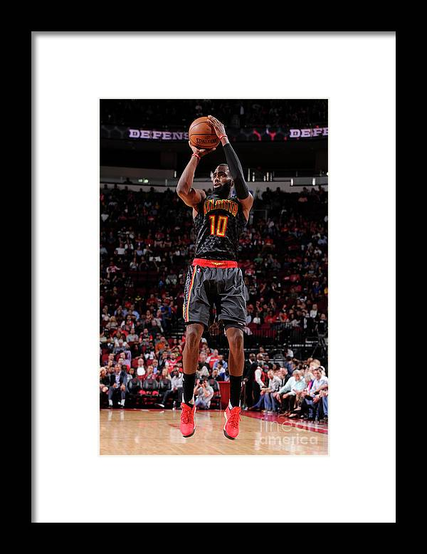 Tim Hardaway Jr. Framed Print featuring the photograph Atlanta Hawks V Houston Rockets by Bill Baptist