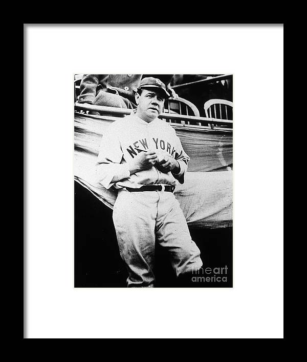 People Framed Print featuring the photograph Babe Ruth Signing Ball by Transcendental Graphics