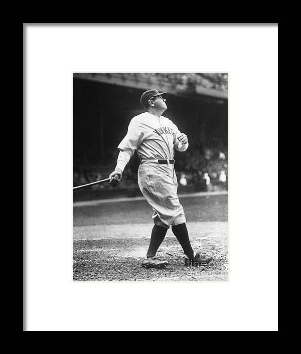 People Framed Print featuring the photograph Babe Ruth Watches One Fly by Transcendental Graphics