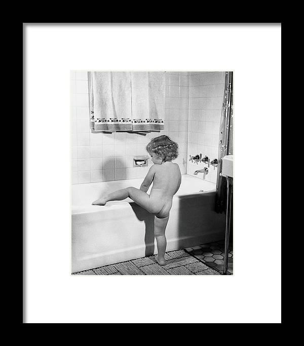 Toddler Framed Print featuring the photograph Baby Girl Climbing Into Bath Tub by H. Armstrong Roberts