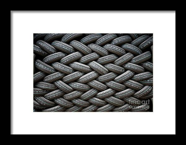 Stack Framed Print featuring the photograph Background Of The Wall Of Tires Laid At by Anna Jurkovska