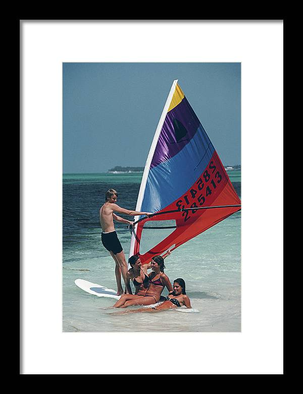 Young Men Framed Print featuring the photograph Bahamas Windsurfing by Slim Aarons
