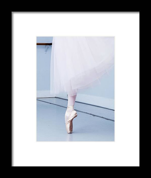 Expertise Framed Print featuring the photograph Ballerina On Pointe Low Angle View by Jonya