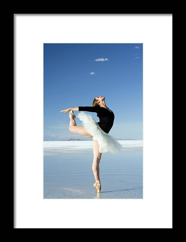 Ballet Dancer Framed Print featuring the photograph Ballerina Tip Toe Pose by Avid creative