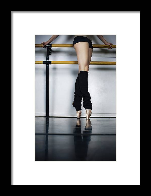 Ballet Dancer Framed Print featuring the photograph Ballet Holdiing Bar In Classic Pointe by Patrik Giardino