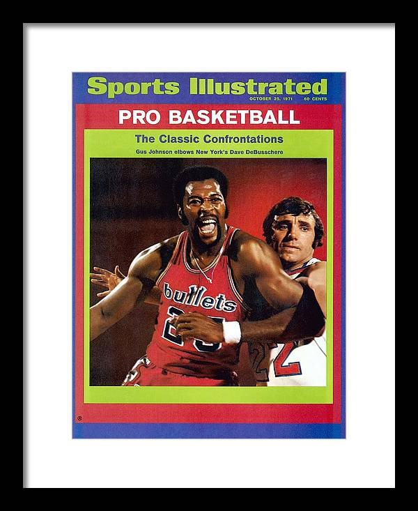 Magazine Cover Framed Print featuring the photograph Baltimore Bullets Gus Johnson And New York Knicks Dave Sports Illustrated Cover by Sports Illustrated