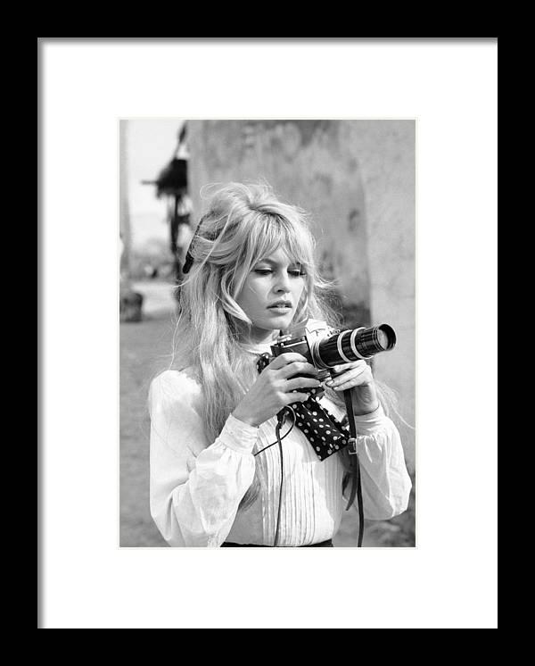 Brigitte Bardot Framed Print featuring the photograph Bardot During Viva Maria Shoot by Ralph Crane