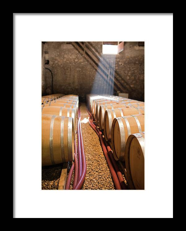 Alcohol Framed Print featuring the photograph Barrels In Wine Cellar by Johner Images
