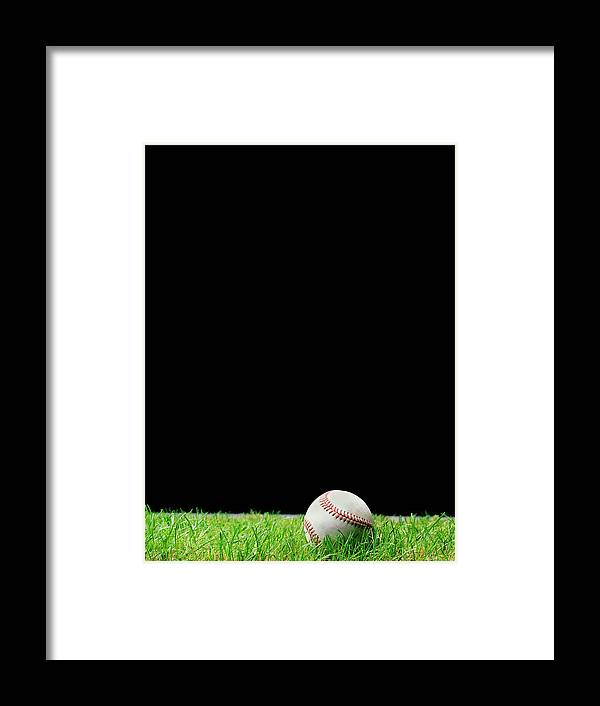 Grass Framed Print featuring the photograph Baseball On Grass At Night Time by Peter Dazeley