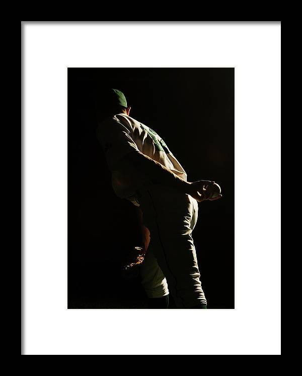 Three Quarter Length Framed Print featuring the photograph Baseball Pitcher Holding Ball Behind by Pm Images