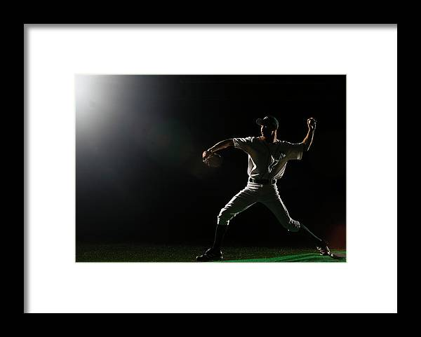 Human Arm Framed Print featuring the photograph Baseball Pitcher Releasing Ball by Pm Images