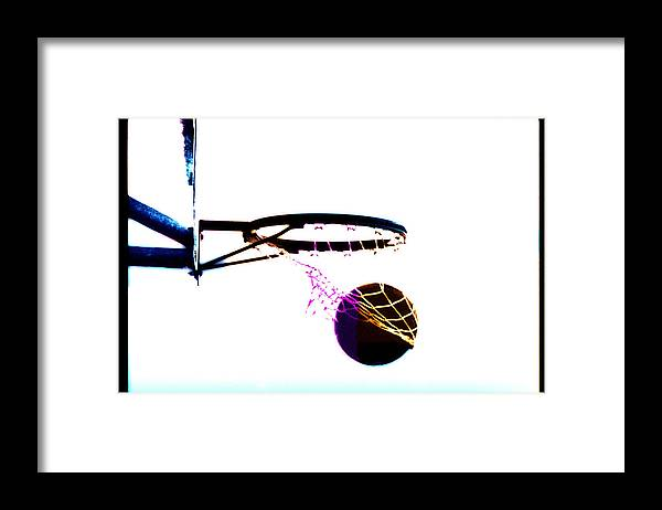 Scoring Framed Print featuring the photograph Basketball Going Through Net, Close-up by Cyberimage
