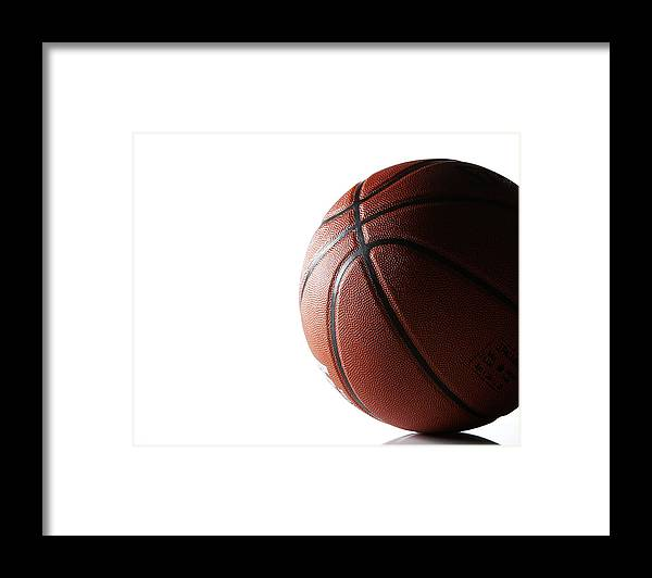 Recreational Pursuit Framed Print featuring the photograph Basketball On White Background by Thomas Northcut