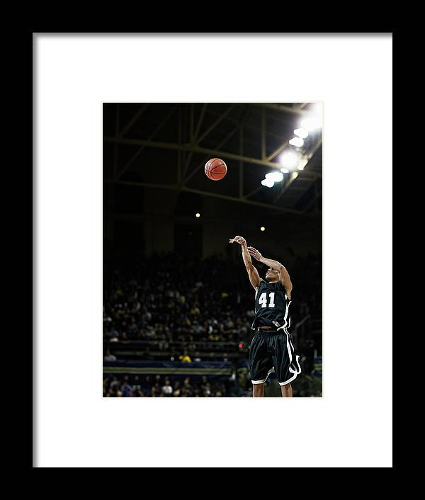Expertise Framed Print featuring the photograph Basketball Player Shooting Jump Shot In by Thomas Barwick