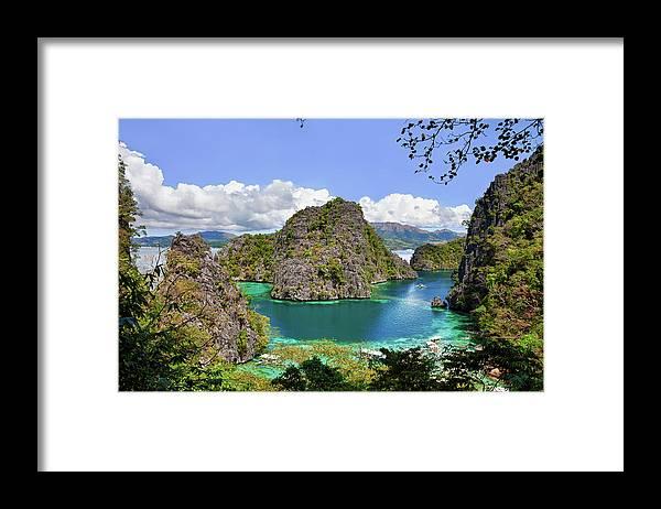 Scenics Framed Print featuring the photograph Beautiful Blue Lagoon At Kayangan Lake by Fototrav