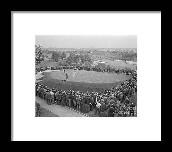 People Framed Print featuring the photograph Ben Hogan Putting As Others Watch by Bettmann