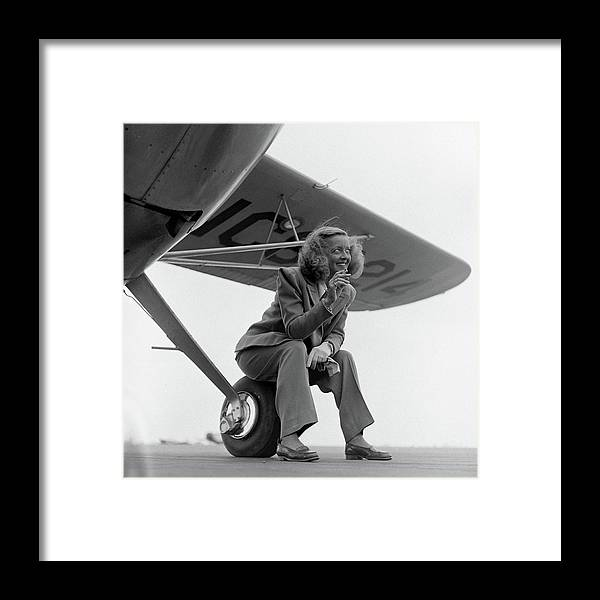 Timeincown Framed Print featuring the photograph Bette Davis With Airplane, 1947 by Loomis Dean