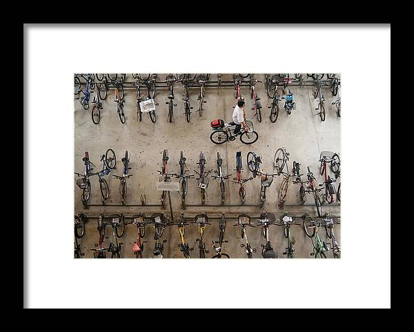 People Framed Print featuring the photograph Bicycle Park At Boon Lay Mrt Station by Kokkai Ng