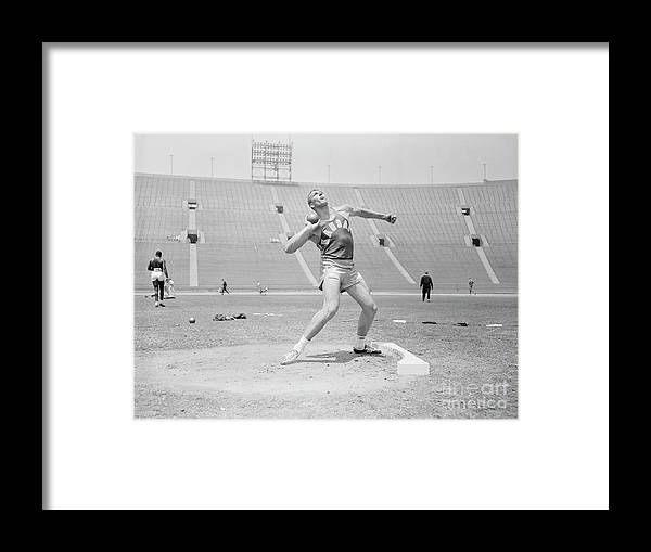 People Framed Print featuring the photograph Bill Nieder Holding A Shotput by Bettmann