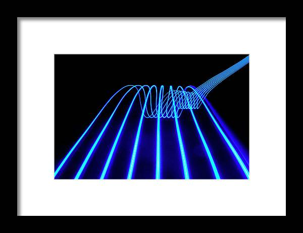 Laser Framed Print featuring the photograph Blue Abstract Coloured Lights Trails by John Rensten