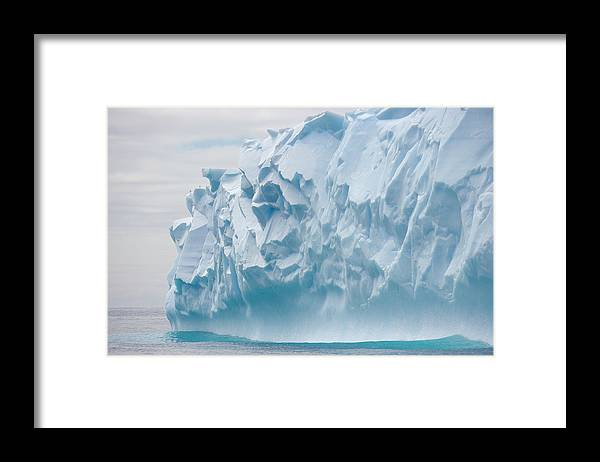 Scenics Framed Print featuring the photograph Blue Iceberg Carved By Waves Floats In by Eastcott Momatiuk