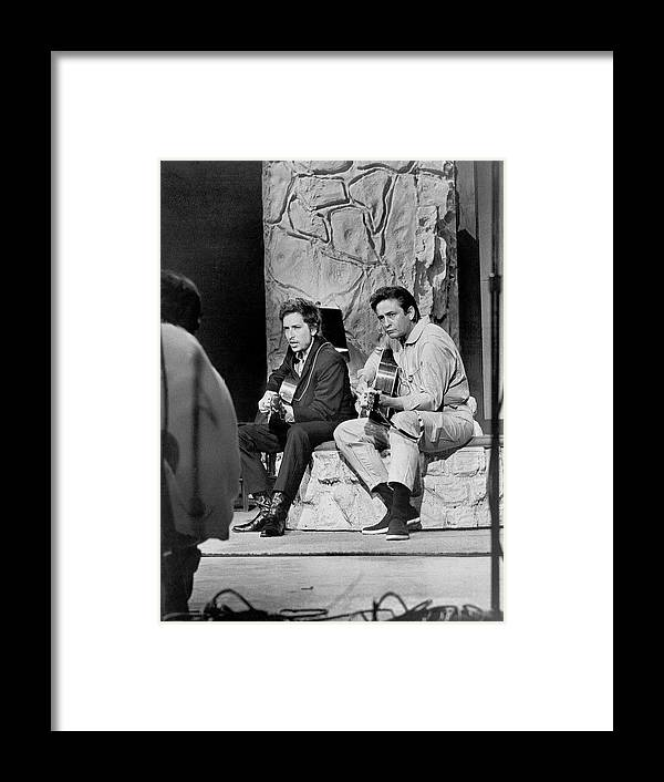 Music Framed Print featuring the photograph Bob Dylan & Johnny Cash by Michael Ochs Archives