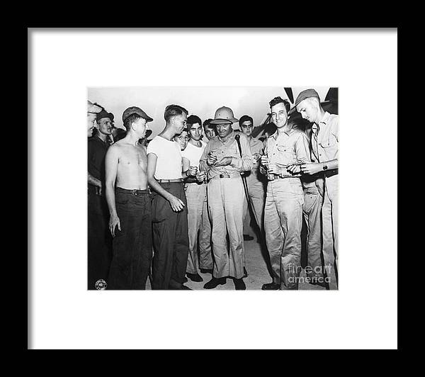 People Framed Print featuring the photograph Bob Hope Signing Autograph For Soldiers by Bettmann