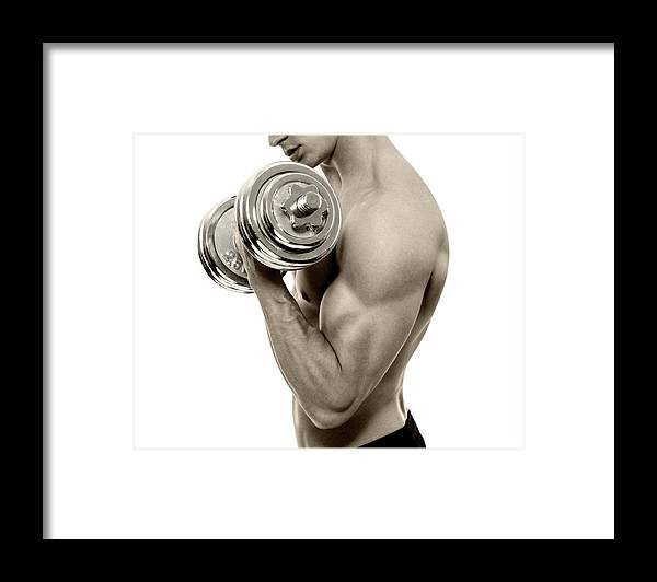 Young Men Framed Print featuring the photograph Body Builder Exercising by Gilaxia