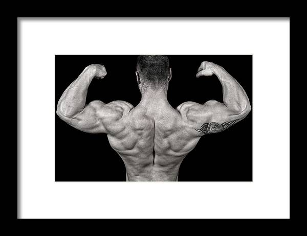 Toughness Framed Print featuring the photograph Bodybuilder Posing by Vuk8691