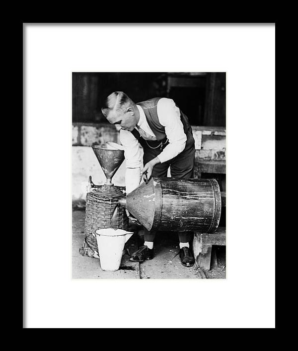 Social Issues Framed Print featuring the photograph Bootlegging by Fox Photos
