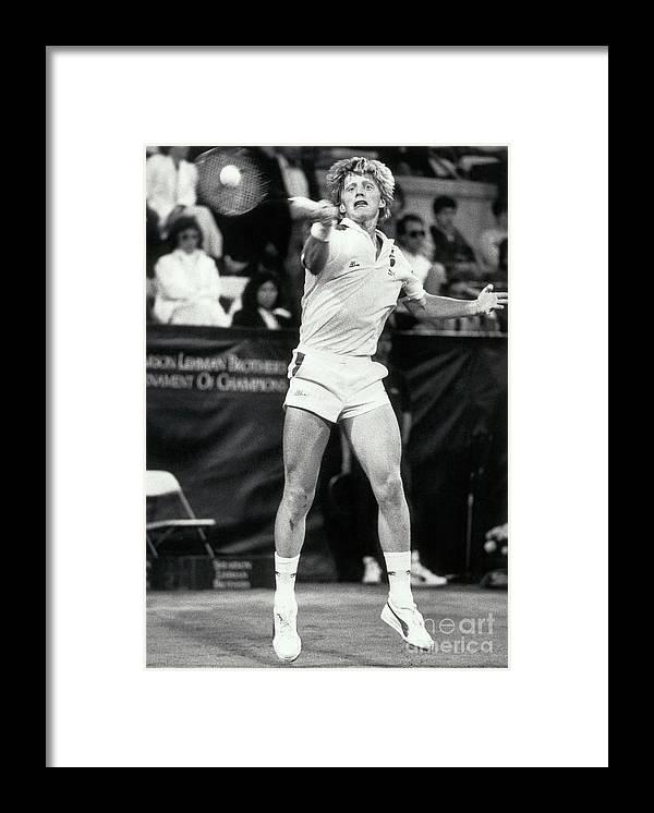 1980-1989 Framed Print featuring the photograph Boris Becker Hitting Return Shot by Bettmann