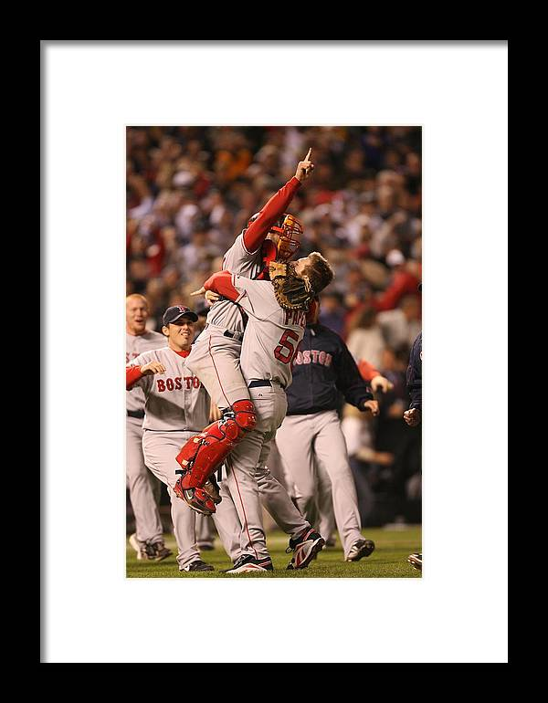 Celebration Framed Print featuring the photograph Boston Red Sox V Colorado Rockies by Brad Mangin