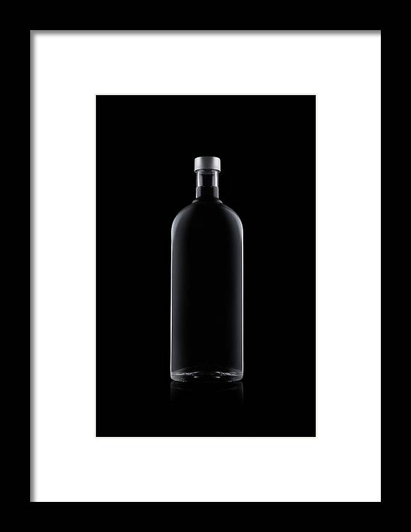 Black Color Framed Print featuring the photograph Bottle Of Water Isolated On Black by Kedsanee