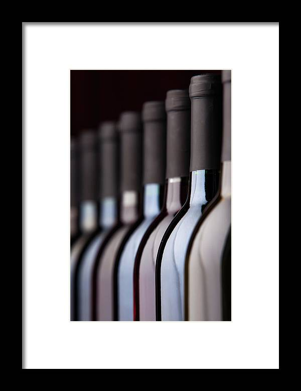 Alcohol Framed Print featuring the photograph Bottles Of Wine In A Row by Halbergman