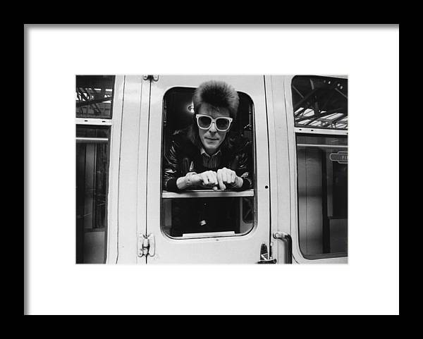David Bowie Framed Print featuring the photograph Bowie On The Rails by Smith