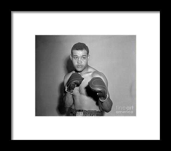 People Framed Print featuring the photograph Boxer Joe Louis Wearing Boxing Gloves by Bettmann