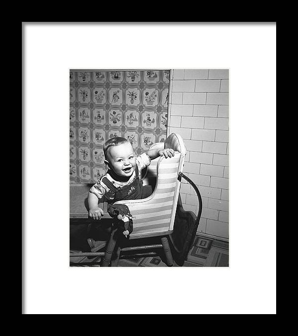 Child Framed Print featuring the photograph Boy 2-3 Sitting In High Chair, B&w by George Marks