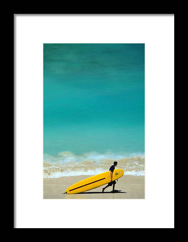 Water's Edge Framed Print featuring the photograph Boy With Yellow Surfboard At Waikiki by Ann Cecil