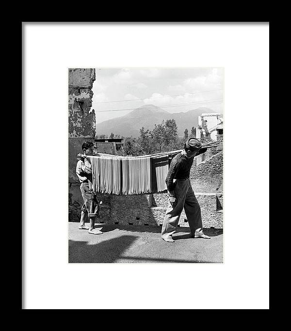 Working Framed Print featuring the photograph Boys Working In Pasta Factory Carry by Alfred Eisenstaedt