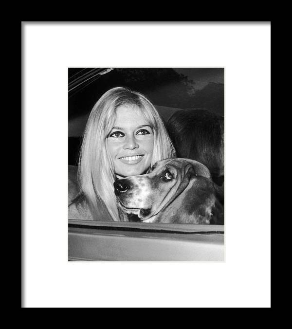 People Framed Print featuring the photograph Brigitte Bardot In London In The 1960s by Keystone-france